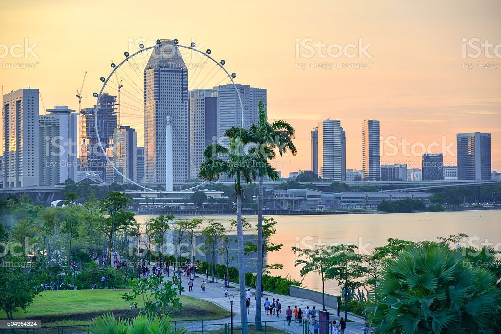 Sunset over Singapore Flyer stock photo