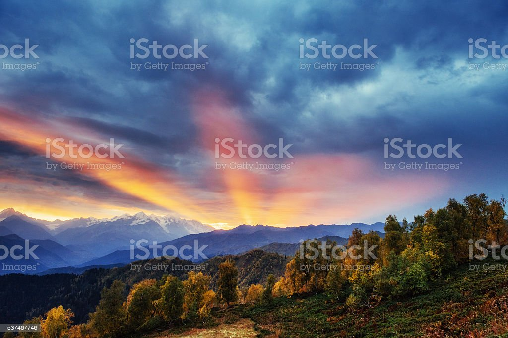 Sunset over snow-capped mountain peaks. stock photo