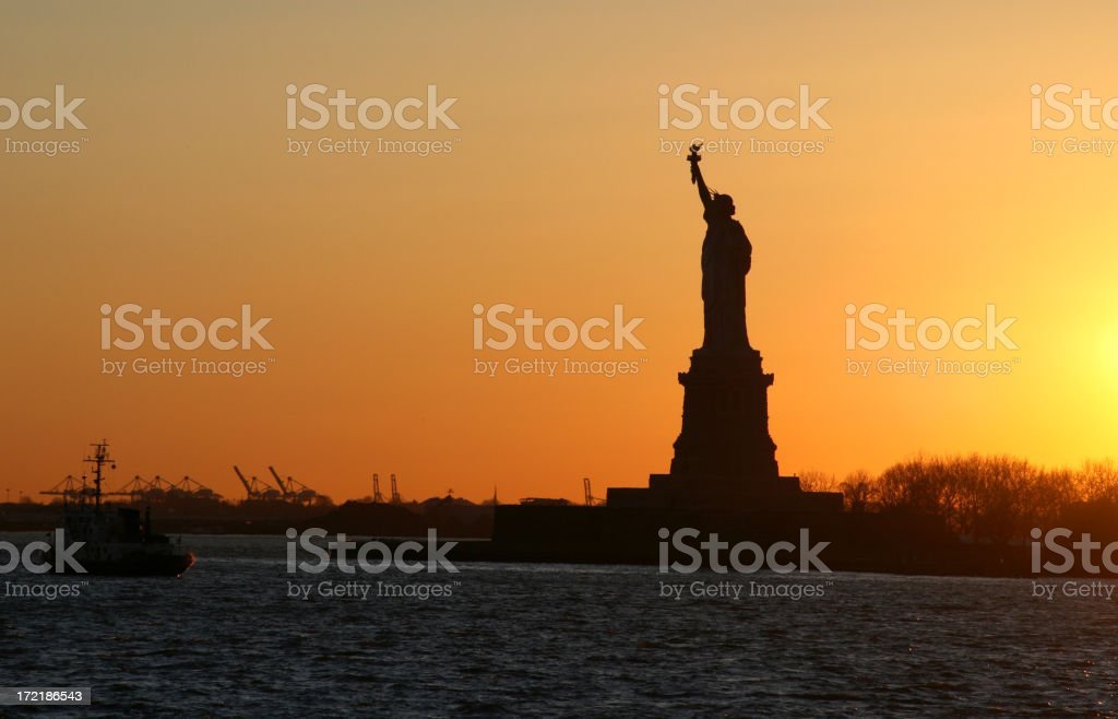 Sunset over Statue of Liberty royalty-free stock photo