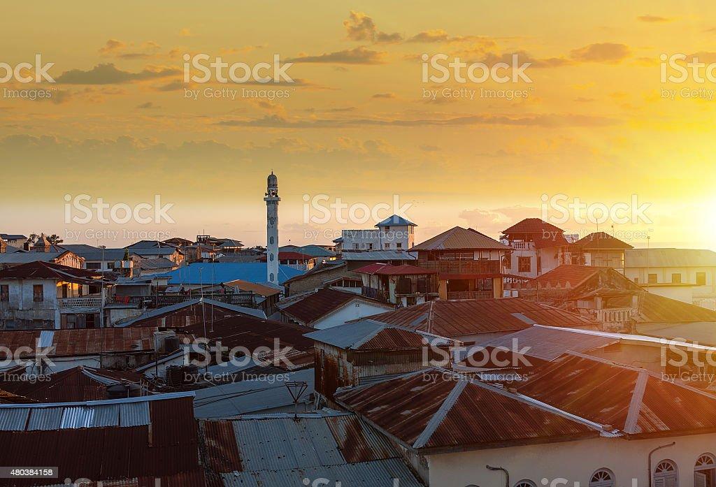 sunset over stone town zanzibar stock photo