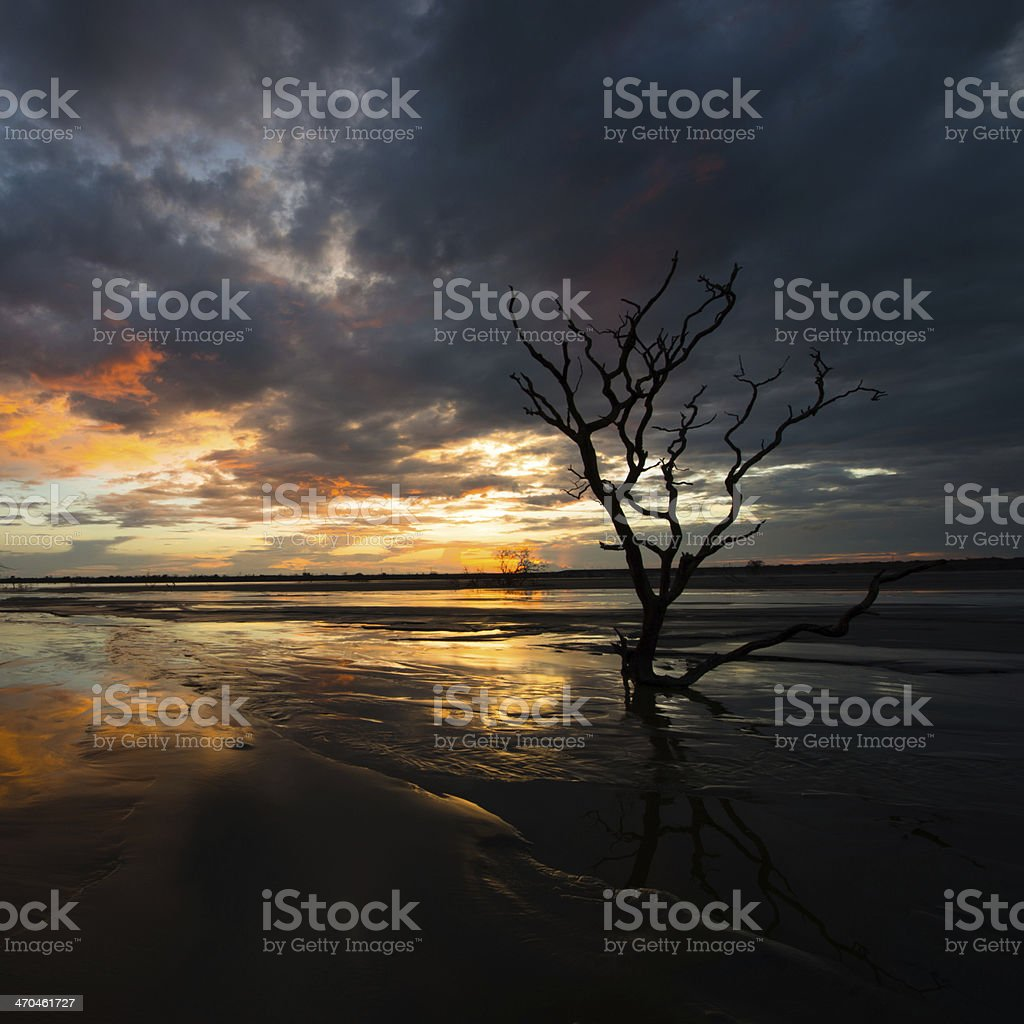 Sunset over tailings dam stock photo