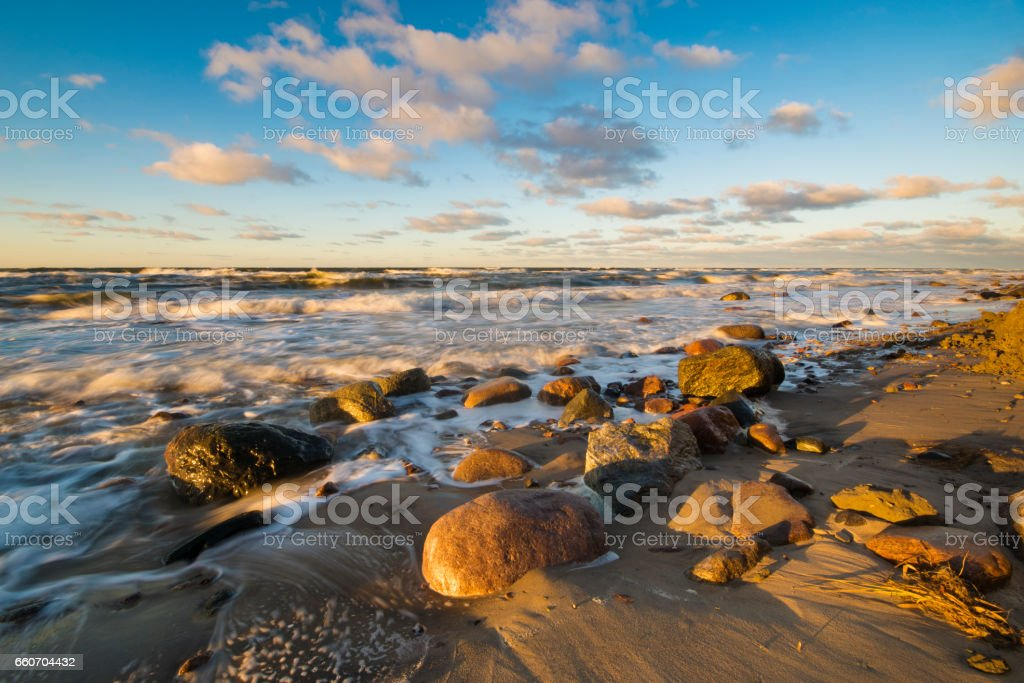 Sunset over the beach and cliffs in Wolinski National Park, Baltic, Poland stock photo