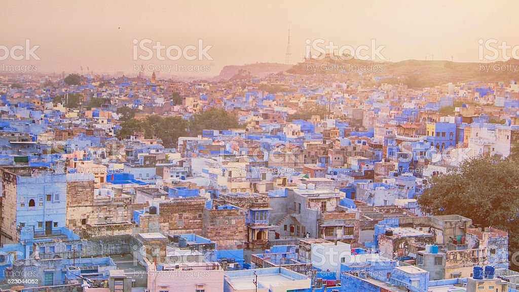 Sunset over the blue city stock photo