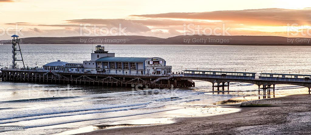 Sunset over the Bournemouth pier stock photo