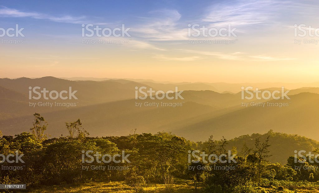 Sunset over the Cardamom Hills, Periyar, Kerala, India. stock photo