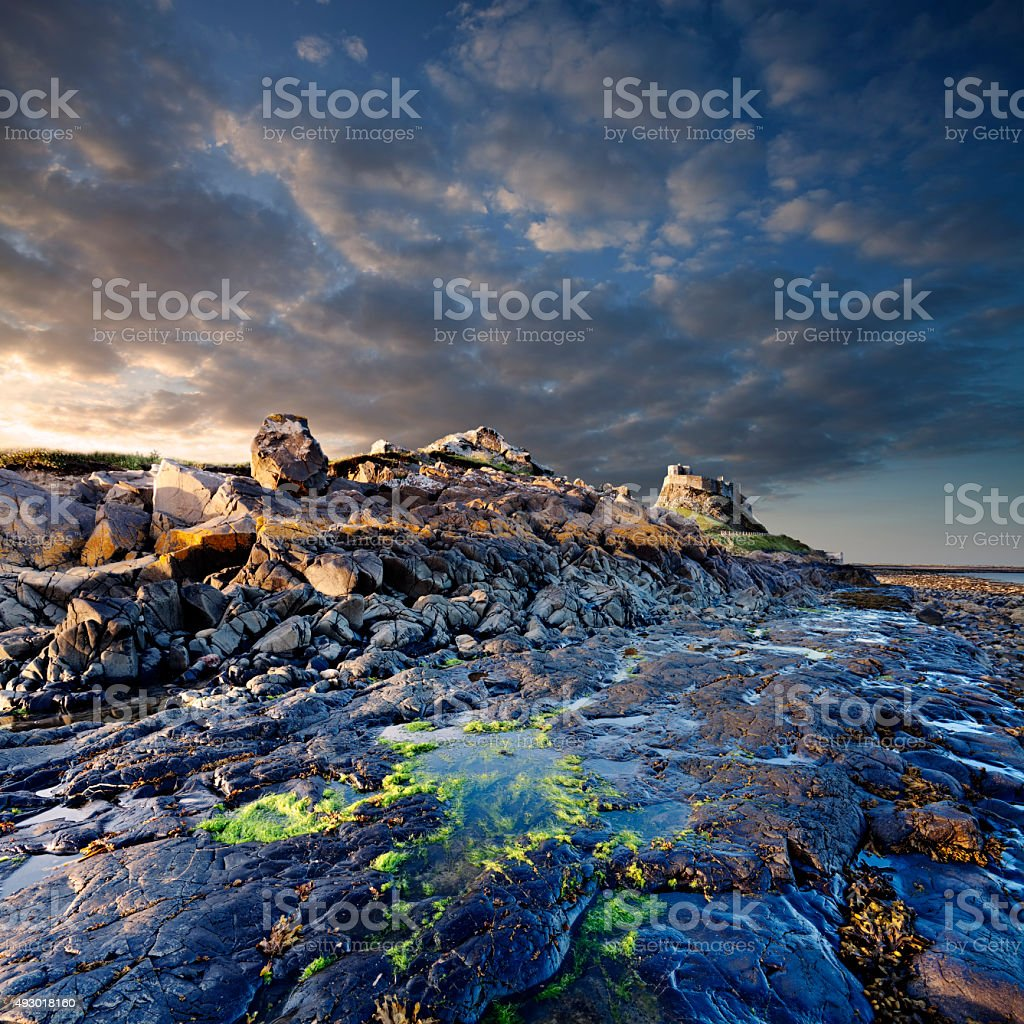 Sunset over the castle on Lindisfarne, Holy Island, England stock photo