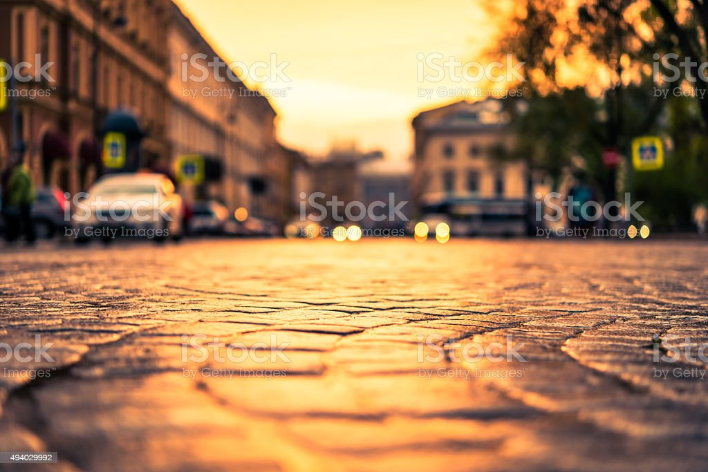 Sunset over the central city square, headlights from cars stock photo