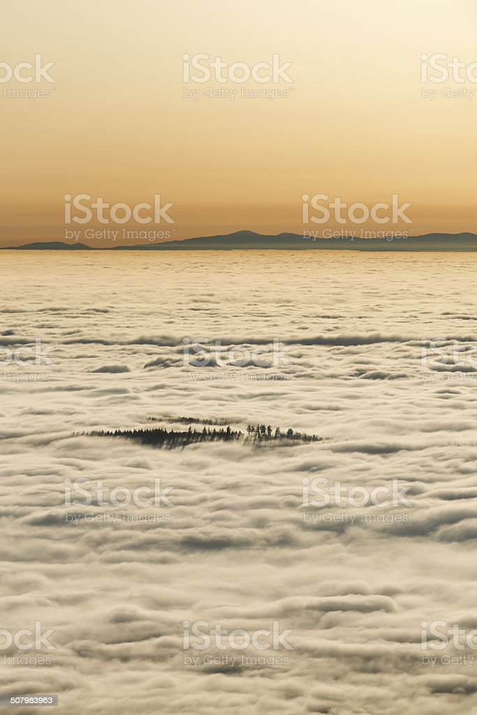 Sunset over the clouds stock photo