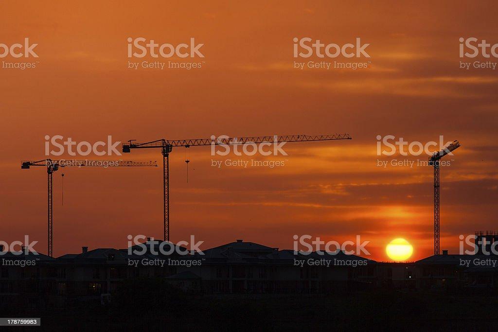 Sunset over the construction crane stock photo