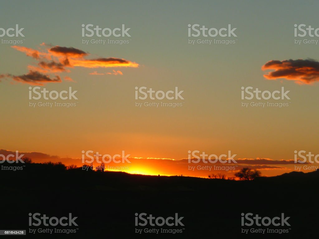 Sunset over the desert stock photo
