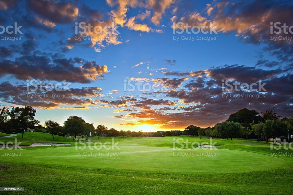 Sunset over the golf course stock photo