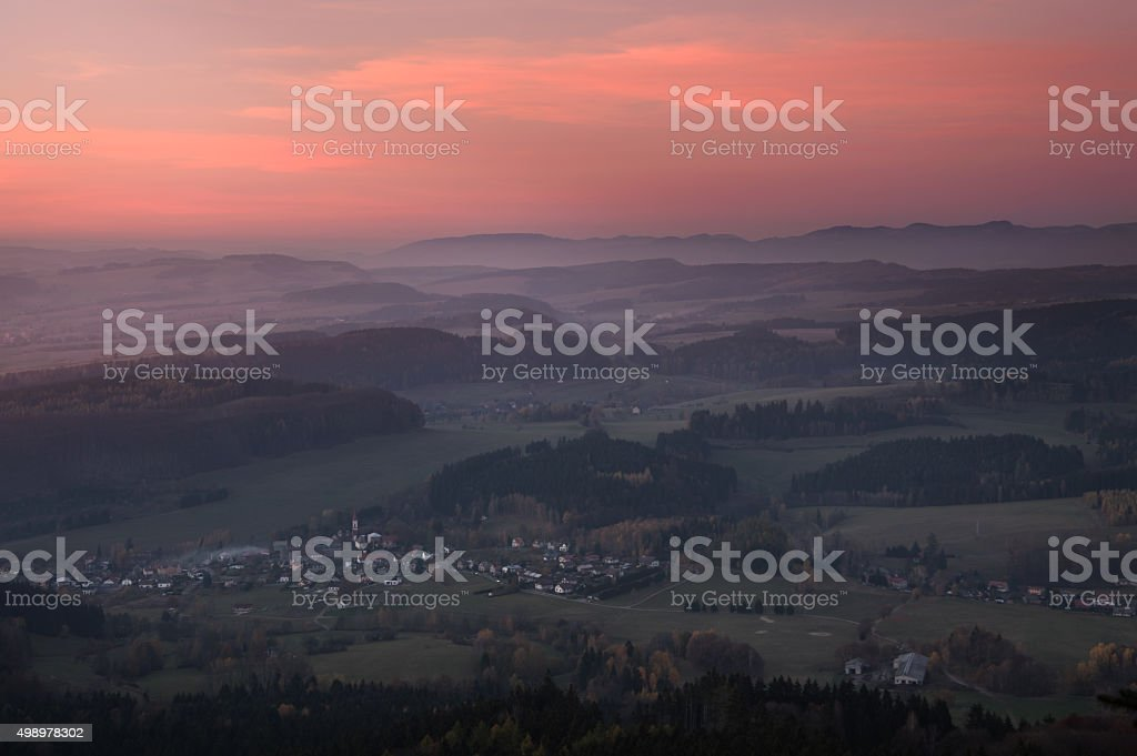 Sunset over the hills in fog stock photo