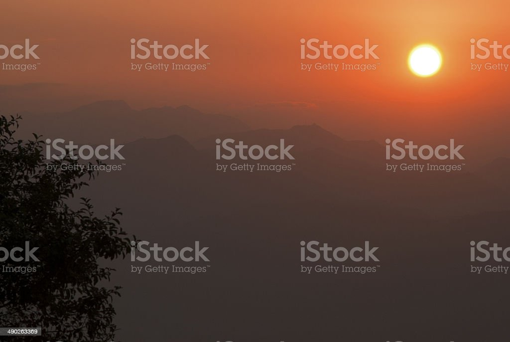 Sunset over the hills royalty-free stock photo