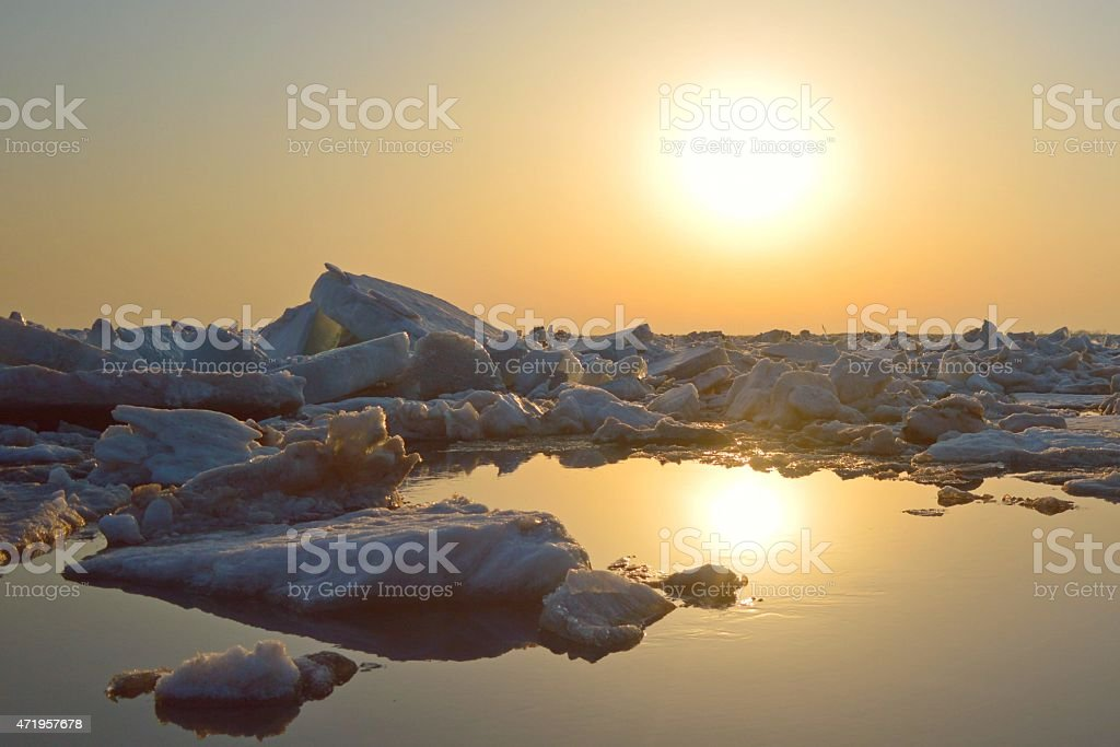 Sunset over the ice lifeless planet :) stock photo