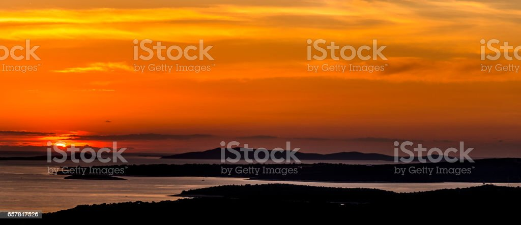 sunset over the islands stock photo
