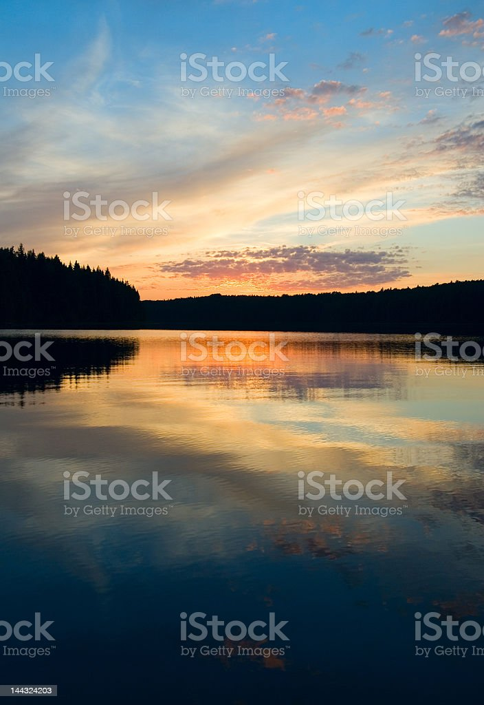 sunset over the lake and forest royalty-free stock photo