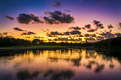 Sunset over the lake near the golf course, tropical resort