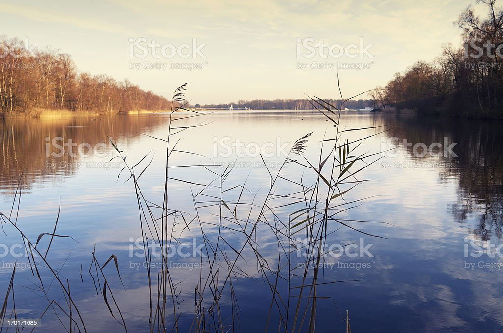 Sunset over the lake with clouds reflected in  water, Belgium royalty-free stock photo