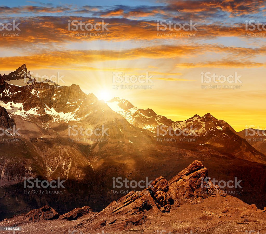 Sunset over the mountain Zinalrothorn of the Pennine alps stock photo
