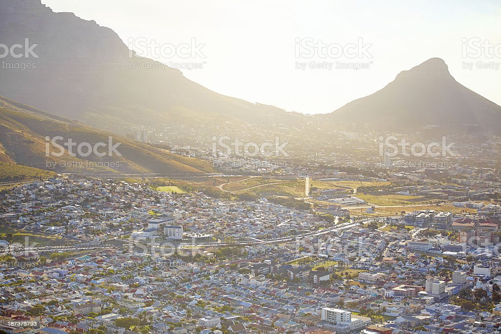 Sunset over the mountains and city royalty-free stock photo