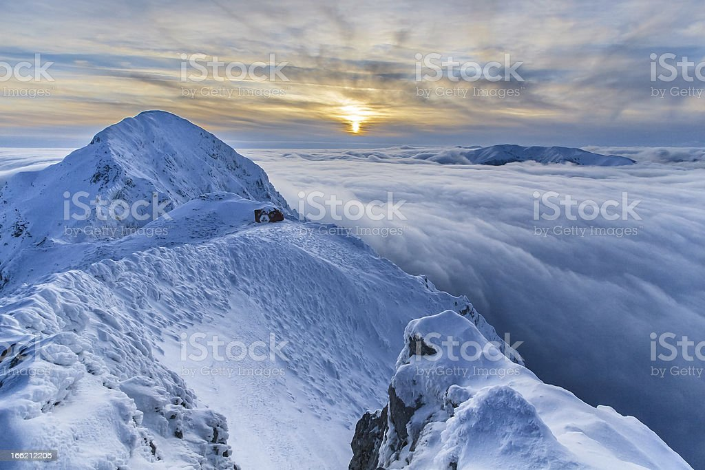 sunset over the mountains and clouds in winter royalty-free stock photo