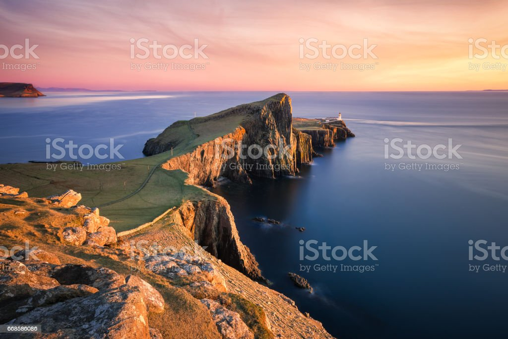 Sunset over the Neist Point Lighthouse, Isle of Skye, Scotland, UK stock photo