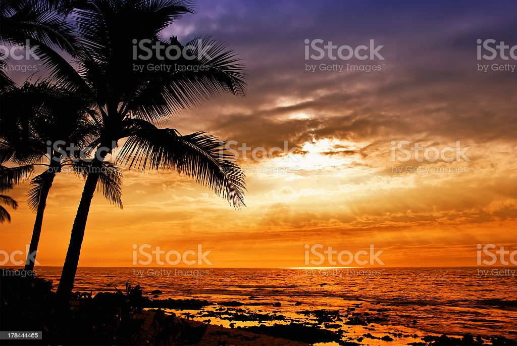 Sunset Over the Ocean and Island of Hawaii stock photo