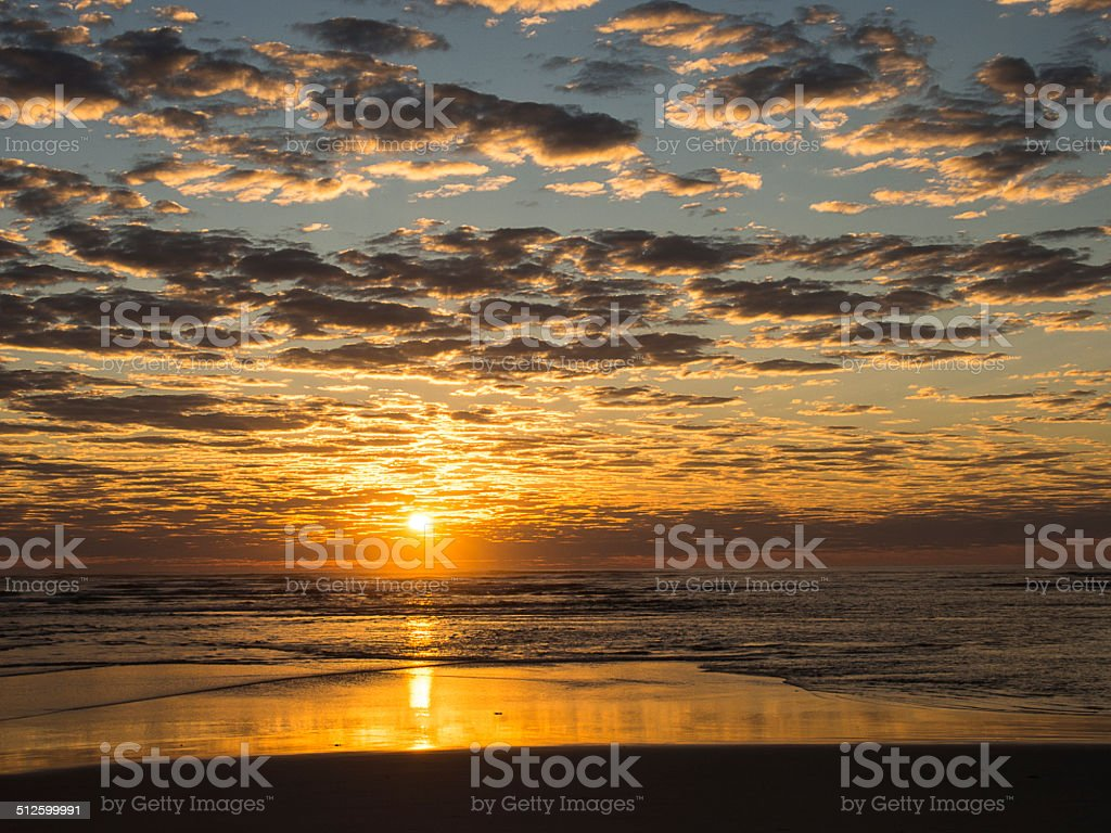 Sunset over the ocean stock photo