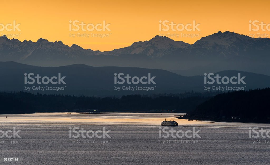 Sunset over the Olympic Mountains stock photo