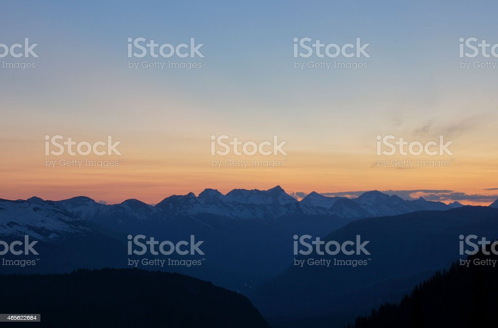 Sunset over the Rocky Mountains in Glacier National Park stock photo