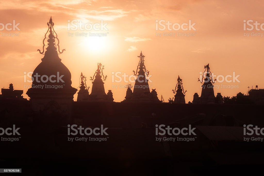 Sunset over the roofs in the fog stock photo