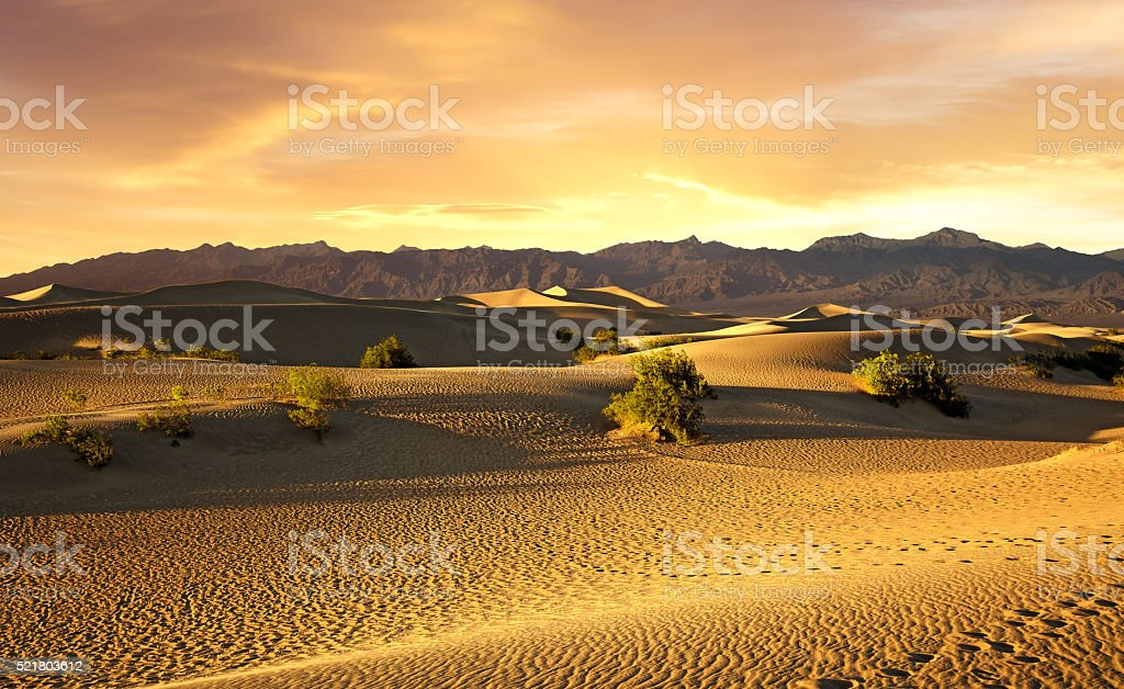 sunset over the sand dunes in the Death Valley stock photo