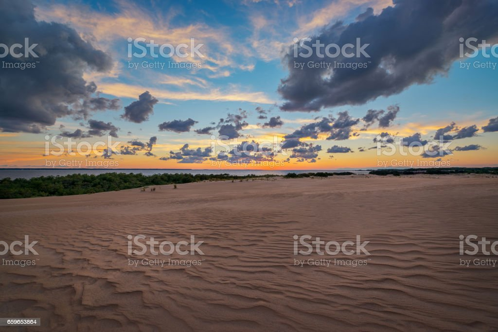 Sunset over the sand dunes in the Outer Banks. stock photo