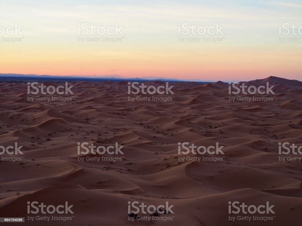 Sunset over the sand dunes stock photo