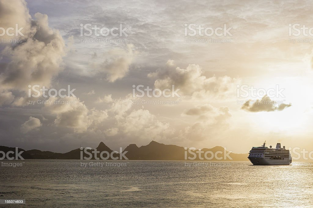 Sunset over the sea with a cruise ship in Grenadines stock photo