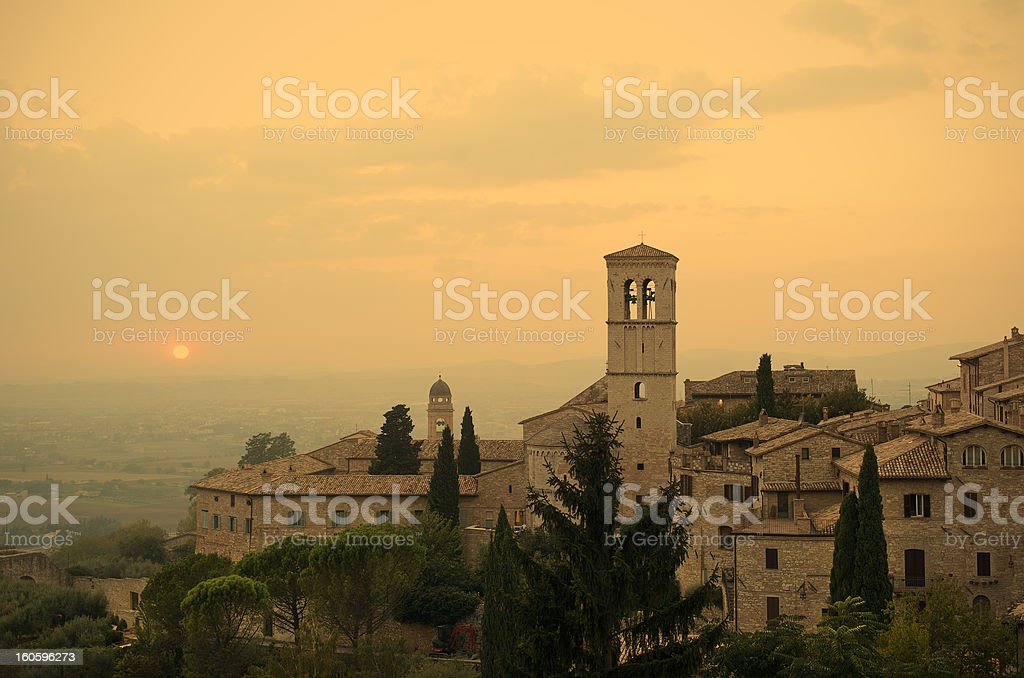 Sunset over the town of Assisi, Umbria, Italy stock photo