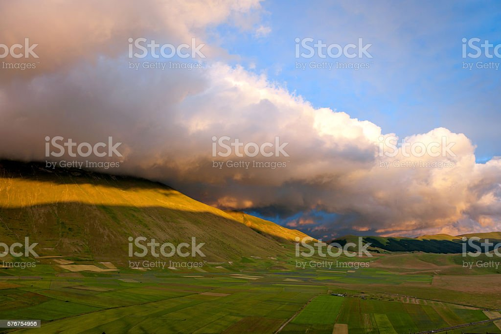 Sunset over the valley after the storm, Castelluccio,  Sibillini , Italy stock photo