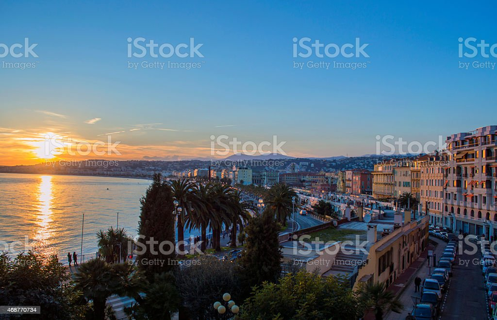 Sunset over the water in the city of Nice stock photo