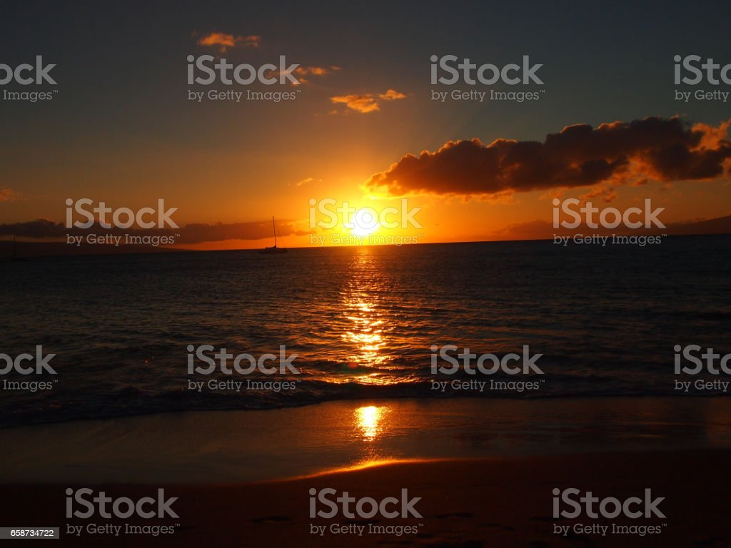 Sunset over the waters of Maui stock photo