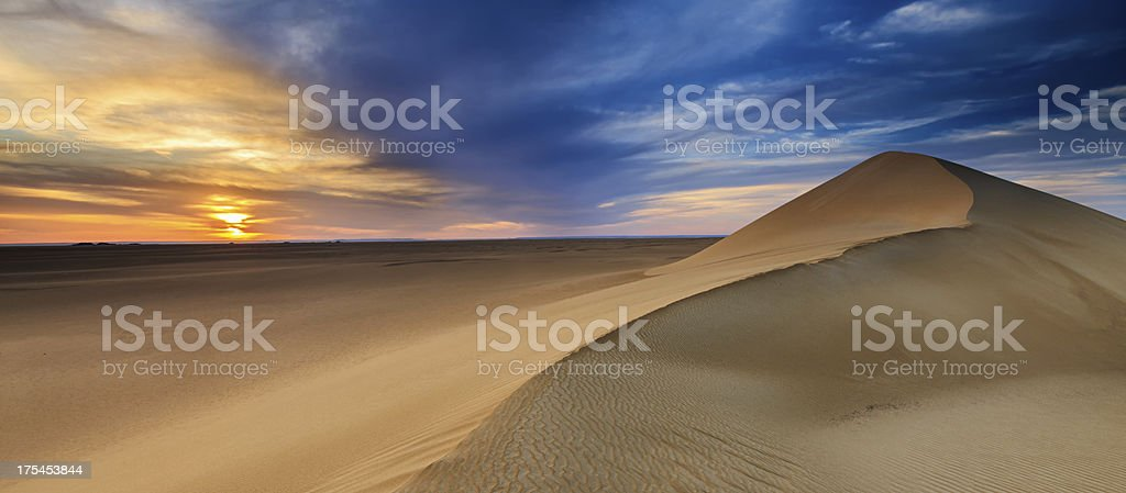 Sunset over The Western Sahara Desert in Africa stock photo