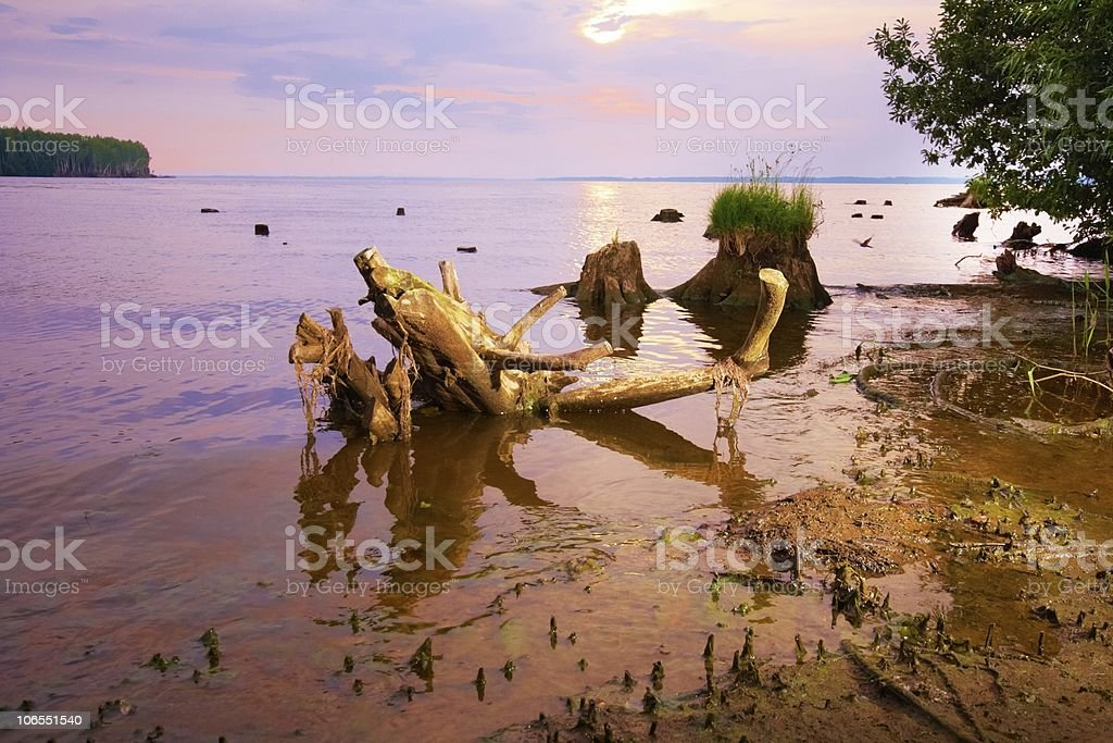sunset over water. stock photo