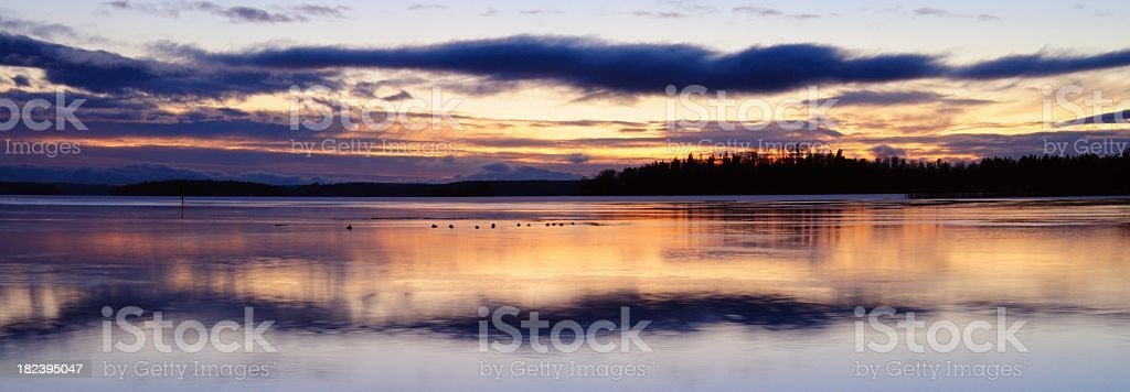 Sunset over winter lake royalty-free stock photo