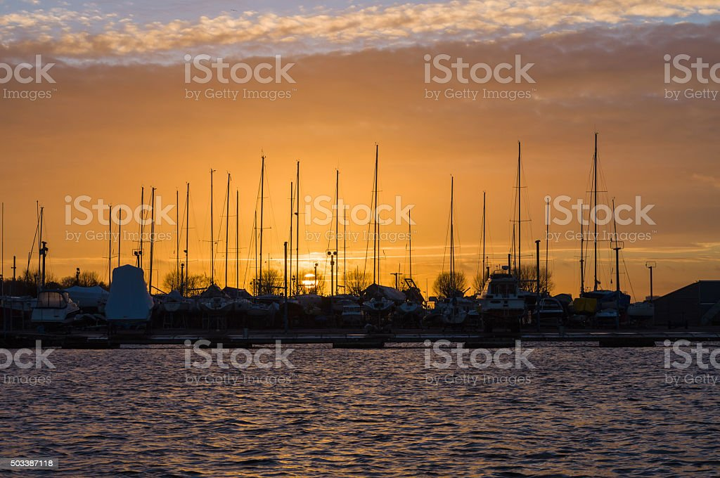 Sunset over yacht harbor stock photo