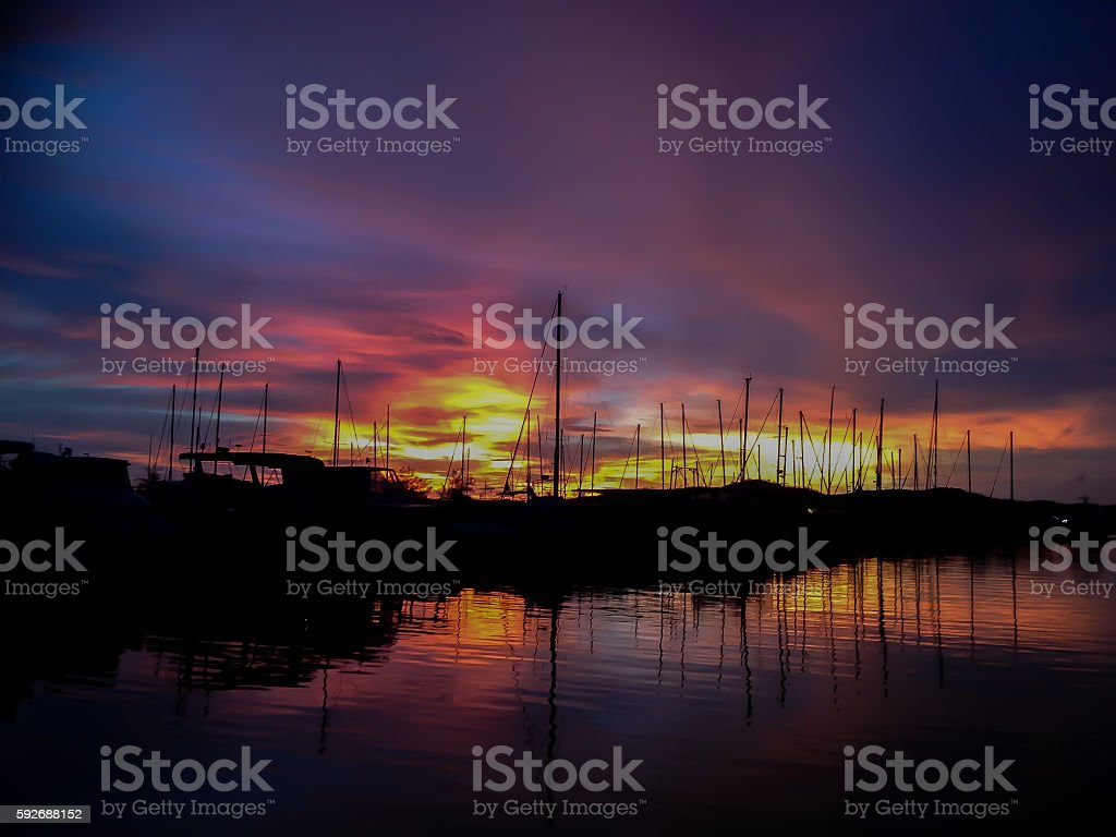 Sunset overlooking Royal Papua Yacht Club Marina Port Moresby PNG stock photo