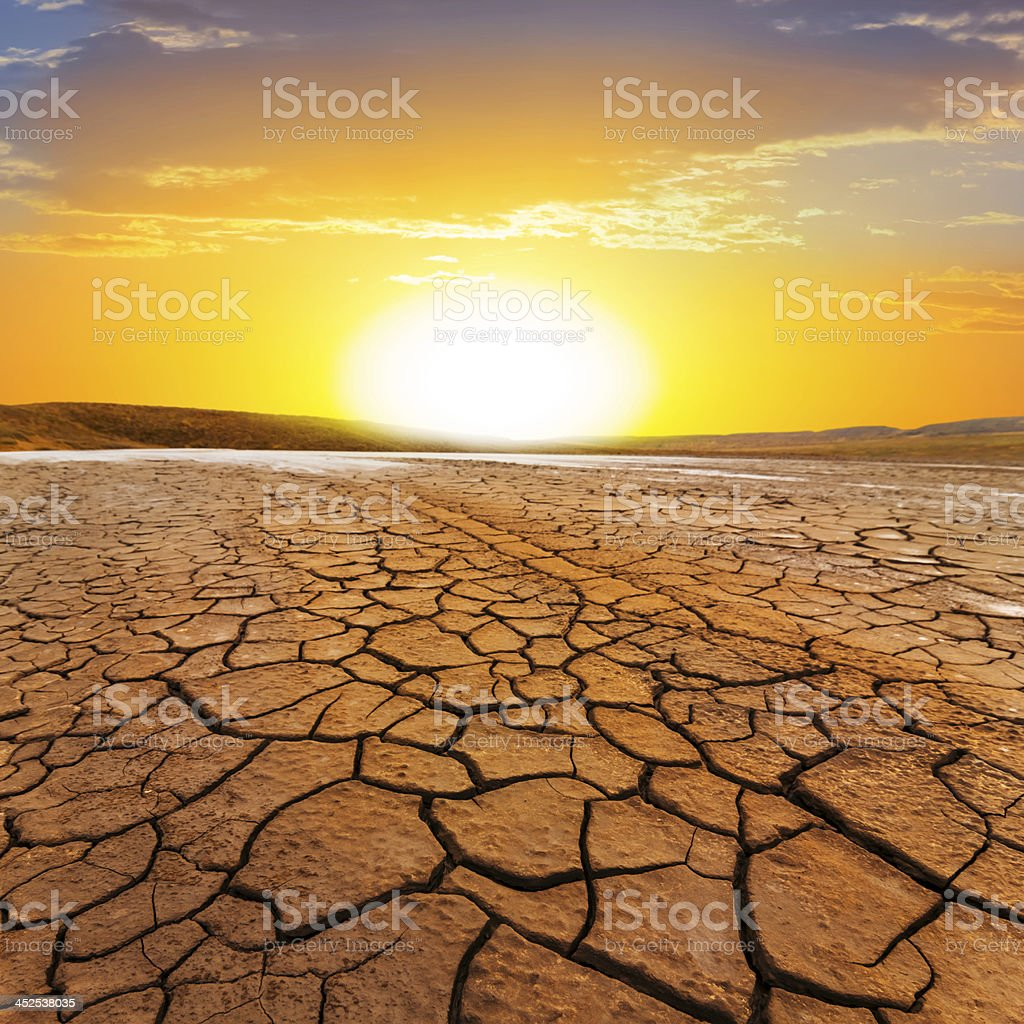 sunset ower a dry land stock photo
