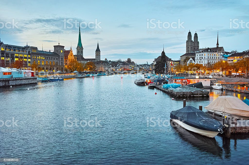 Sunset panorama of Zurich and reflection in Limmat River, Switzerland stock photo