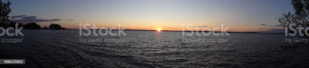 Sunset panorama over the Vättern lake in Sweden stock photo