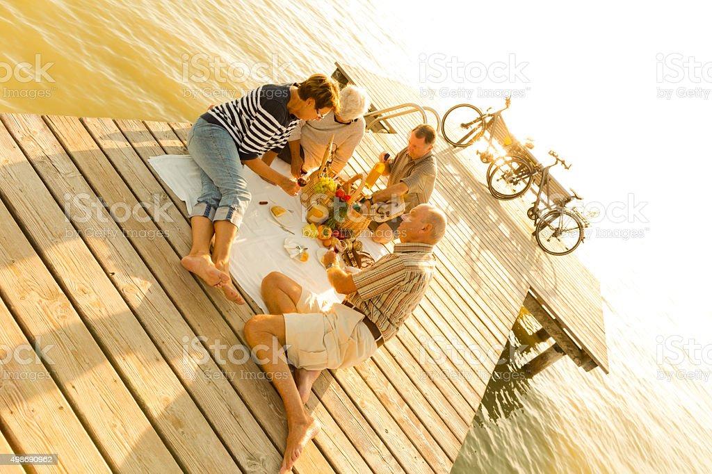 sunset picnic on pier stock photo