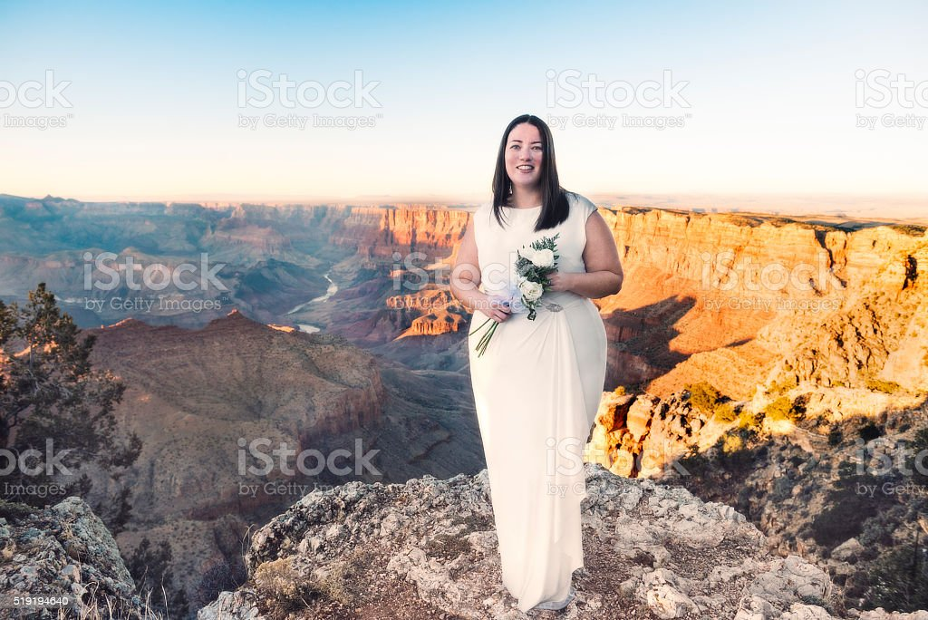 Sunset Portrait of Smiling Destination Bride in Grand Canyon USA stock photo