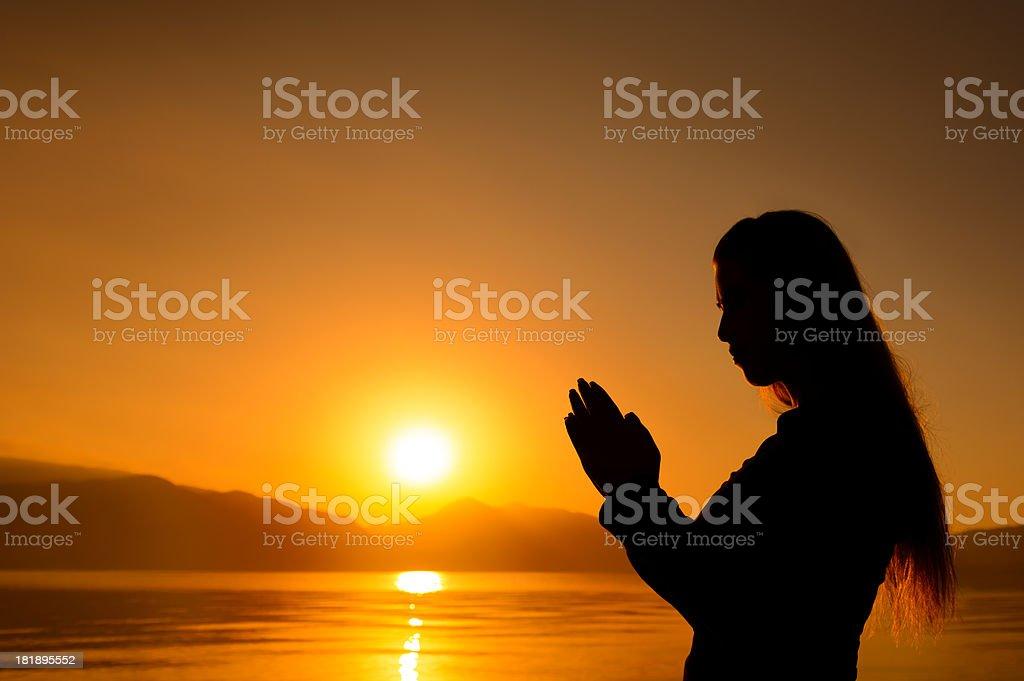 sunset pray royalty-free stock photo